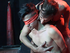 Bare youthful sub gets eyes covered at the basement
